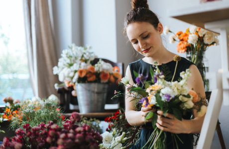 Woman tending to flowers