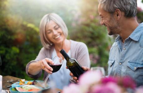 Older couple enjoy a glass of wine