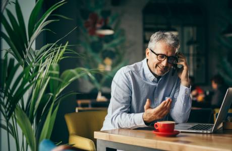 Man talking on phone in coffee shop